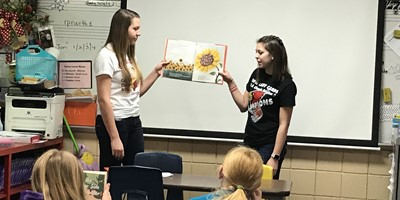 LCHS STLP Reading to NLES for Read Across America Week